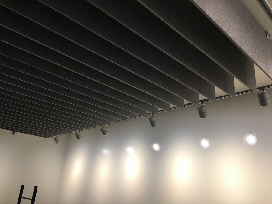ezoBord -  Geo Tiles used on Wall and Ceiling - Ezobord Blades to boardroom ceiling finished